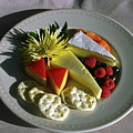 Cheese Wedges With Crackers And Fruit by Sally Weigand
