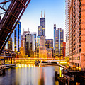 Chicago Skyline At Night And Kinzie Bridge by Paul Velgos