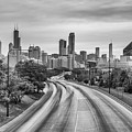 Chicago Skyline In Black And White From The Mccormick Place Pedestrian Bridge Over Lake Shore Drive  by Silvio Ligutti