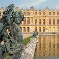 Child Statues At The Palace Of Versailles by James Udall