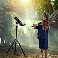 Children In Folk Costumes Playing Violin In Thailand by Somchai Sanvongchaiya
