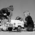 Children Play At Repairing Toy Car by H. Armstrong Roberts/ClassicStock