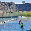 Children Playing In Dierkes Lake In Snake River Above Shoshone Falls Near Twin Falls-idaho  by Ruth Hager