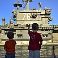 Children Wave As Uss Ronald Reagan by Stocktrek Images