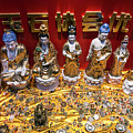 Chinese Religious Trinkets And Statues On Display In Xiamen Chin by Jacek Malipan