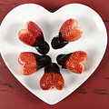 Chocolate Dipped Heart Shaped Strawberries On Heart Shape White Plate by Milleflore Images