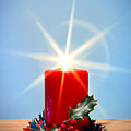 Christmas Candle With Starburst And Holly. by Richard Thomas