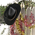 Christmas Cowboy Hat On Fence - Merry Christmas  by Olivier Le Queinec