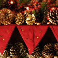 Christmas Decorations Of Garlands And Pine Cones by Mal Bray