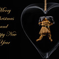 Christmas Greeting With Dancing Straw Dolls In A Heart by Torbjorn Swenelius