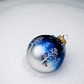 Christmas Ornament In Snow by Jim DeLillo