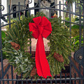 Christmas Ribbon On Iron Door by Susanne Van Hulst
