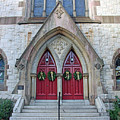 Christmas Wreaths On Red Church Doors by Cora Wandel