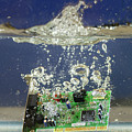 Circuit Board Submerged In Water by Les Palenik