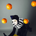 Circus Fashion Mime Juggles With Five Oranges. Photo. by Kireev Art