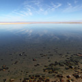Cirrus Clouds And Pebbles In Laguna De Chaxa Chile by James Brunker
