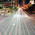 City Light Trails On Street In Downtown by Eric Lo