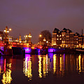 City Scenic From Amsterdam With The Blue Bridge In The Netherlands by Nisangha Ji