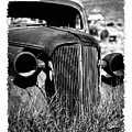 Classic Car Body In Grassy Field by George Oze