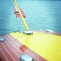 Classic Wooden Boat Stern With Flag 2.0 by Michelle Calkins