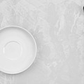 Clean White Dish And An Old Silver Spoon  by Andrey  Godyaykin
