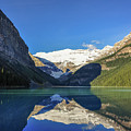 Clear Reflections In The Water At Lake Louise, Canada. by Daniela Constantinescu
