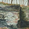 Cleft.  Rock Shelf Fissure And Autumn Leaves by Lynn ACourt