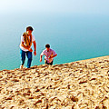 Climbing Up The Dune From Lake Michigan In Sleeping Bear Dunes National Lakeshore-michigan by Ruth Hager
