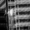 Close Up Of Black And White Glass Building by Jacek Wojnarowski