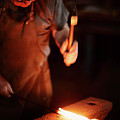 Close-up Of  Blacksmith Forging Hot Iron by Johan Swanepoel