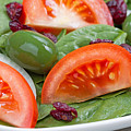 Close Up Of Fresh Spinach Salad On White Plate  by Thomas Baker