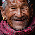 Close Up Portrait Of Smiling Man In Nepal by Global Light Photography - Nicole Leffer