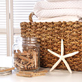 Closeup Of Laundry Basket With Fine Linens  by Sandra Cunningham