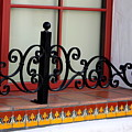 Closeup Of Window Decorated With Terracotta Tiles And Wrought Iron Photograph By Colleen by Colleen Cornelius
