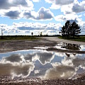 Cloud Reflection In Puddle by Samiksa Art