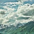 Clouds Alaska Mtns  by Chuck Kuhn
