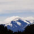 Clouds And Snow On Sierra Blanca by Jon Rossiter