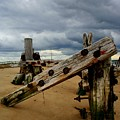 Clouds And Wooden Structure by John Kenealy