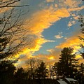 Clouds Catching The Evening Light by Elizabeth Tillar
