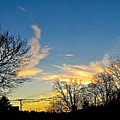 Clouds Dancing To The Sunset Light by Elizabeth Tillar