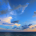Clouds Drifting Over The Ocean by Theresa Campbell