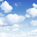 Clouds In Blue Sky by Les Cunliffe