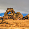 Clouds Over Delicate Arch by Roberta Bragan