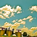 Clouds Over Oil Field Equipent by Chuck Taylor