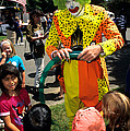 Clown Entertaining Kids by Inga Spence