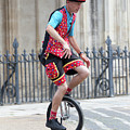 Clown Riding Unicycle In Town by Simon Bratt Photography LRPS
