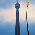 Cn Tower In Toronto With Red Streetlamp by Hans Schrodter