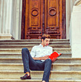 College Student Reading Red Book, Sitting On Stairs, Relaxing Ou by Alexander Image