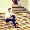 College Student Sitting On Stairs, Relaxing Outside by Alexander Image
