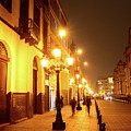 Colonial Street In Central Lima At Night by James Brunker